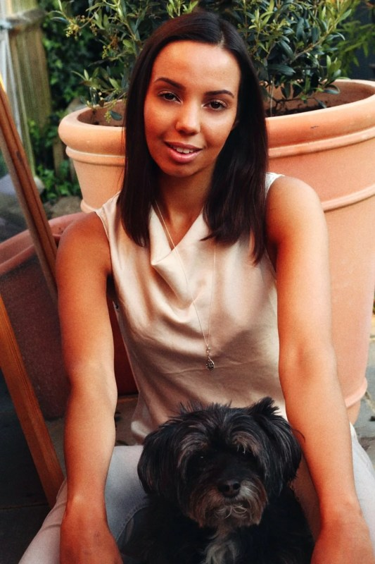 portrait mixed race woman with dog outside for blog on money better than love