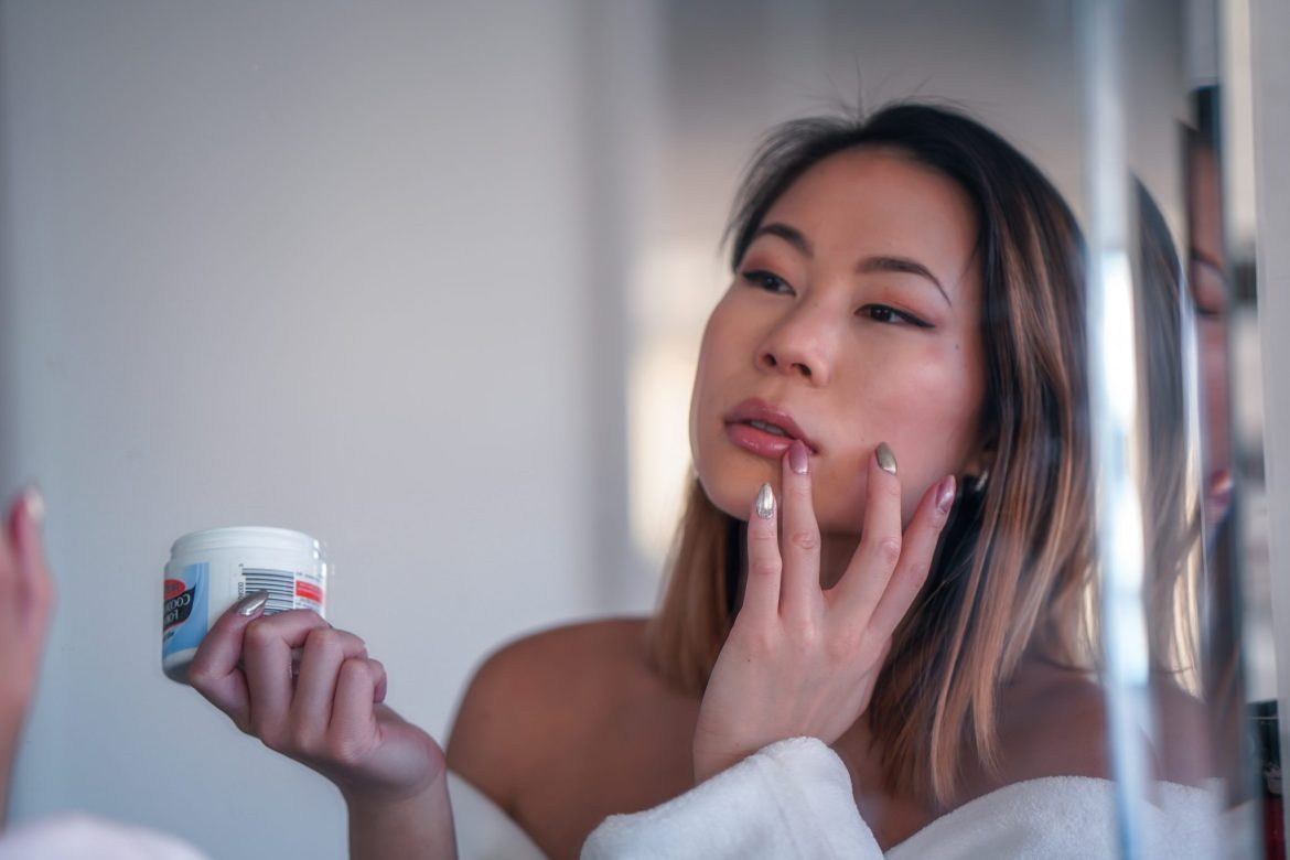 Kasey Ma Beauty Influencer of TheStyleWright Applies Palmer's Coconut Butter Formula as lip balm for chapped lips for dry skincare
