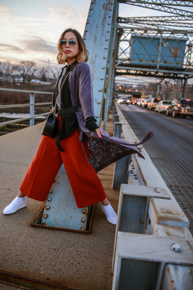 Lifestyle and Fashion Blogger and Influencer Kasey ma of thestylewright wears Tara Jarmon black faux fur with a Mauve dress from Sugarhigh and a squirrel bag from Furla white for New York Fashion Week February 2019