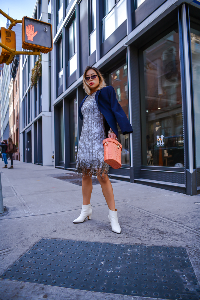 Lifestyle and Fashion Blogger and Influencer Kasey ma of thestylewright wears Elie Tahari with a Brahmin bag and Bill Blass white booties for New York Fashion Week February 2019