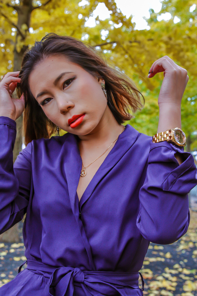 kasey ma of thestylewright wearing blue jumpsuit with jewelry