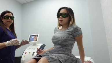 kasey ma of the stylewright sitting up right in laser treatment room