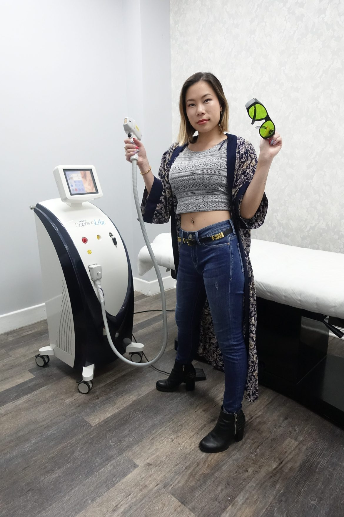 kasey ma of the stylewright posing with protective goggles and laser treatment equipment