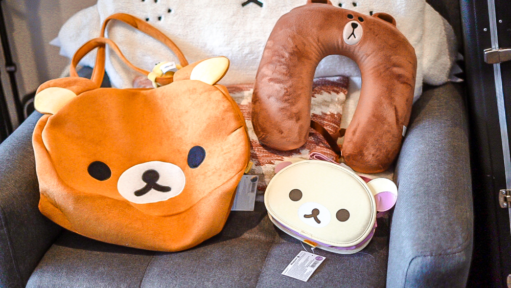 Rilakkuma bag korilakkuma bag chairoigokuma neck pillow on sofa
