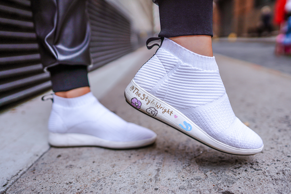 Kasey Ma showing off shoes for New York Fashion Week