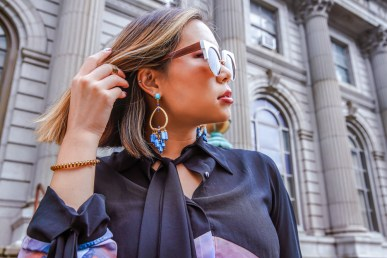 kasey ma in indonesian diversity for new york fashion week holding a jeff wan bag and wearing bill blass shoes in jersey city wearing sequin jewelry earrings for new york fashion week 2019