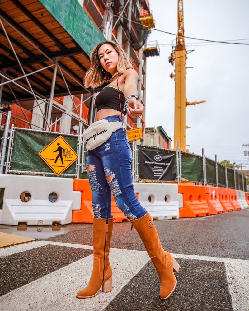 kasey ma in femme luxe, denim jeans by shein, bill blass boots and a champion belt bag for new york fashion week 2019