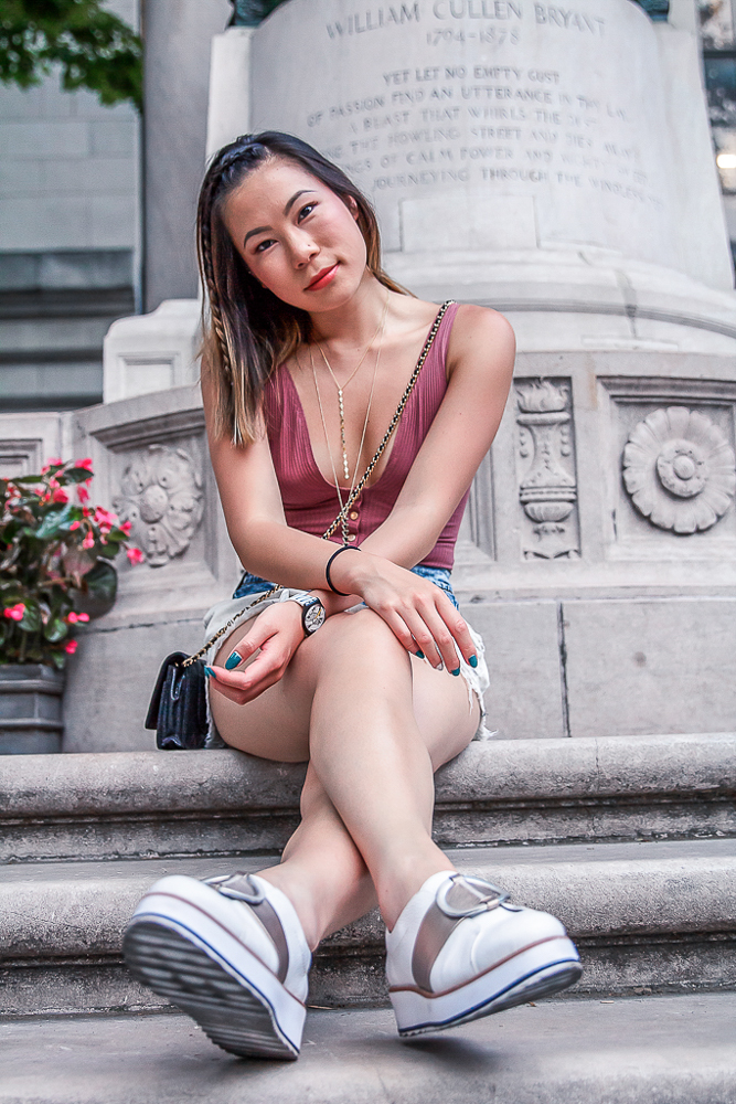 kasey ma of thestylewright wears a pink body suit and white neutral flat shoes as style basics in her wardrobe