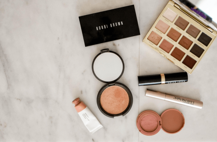 beauty flatlay of bobbi brown eye shadow bronzer and blush