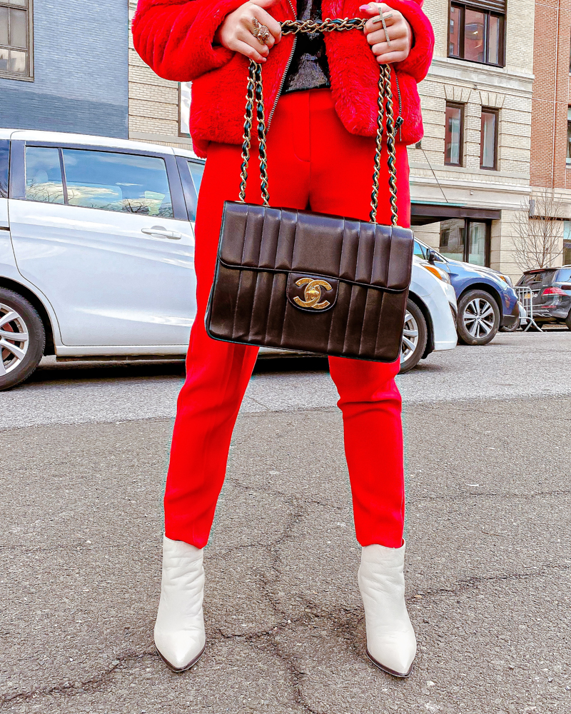 Kasey Ma wearing her vintage black chanel bag and bill blass white boots at NYFW 2020