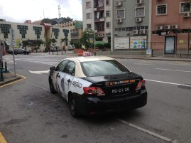 Taxi cab, looks like a police car from the US...