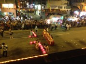 Patiently waiting for the dragon. Once the dragon came, these girls and dignitaries began the walk down the street.