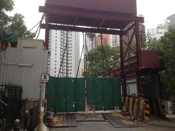 Construction site next to apartment.