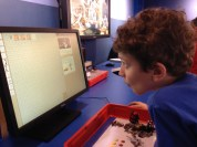 Kiddo focused telling the robot where to move.