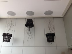 Art- stones all hanging down into the shape of pots/trees.
