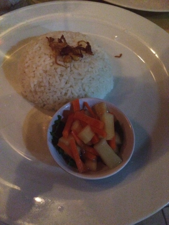 Accompanying rice and pickled veggies