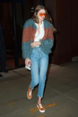 January 18, Teal and auburn shag coat, white t-shirt, Sandro cropped jeans, suede sneakers by M. Gemi, a Gucci phone case and orange tinted sunglasses