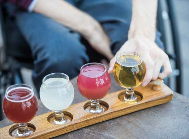 person with four types of alcoholic beverages