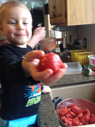 This is Hunter at 3 helping make pizza sauce