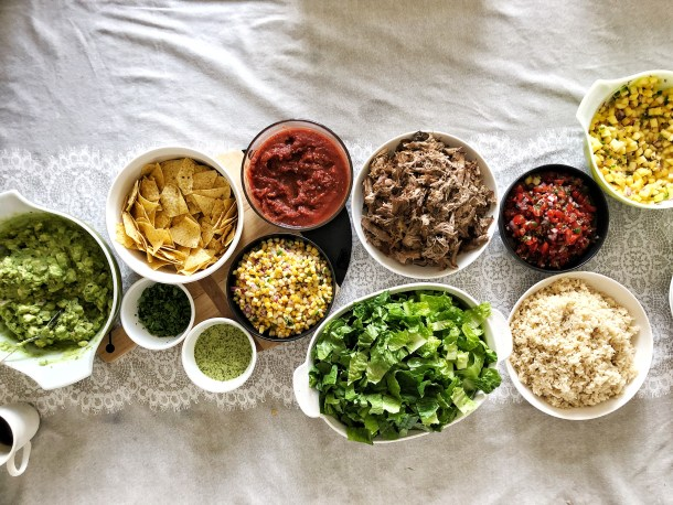 Looking for a fun, delicious way to host? DIY Burrito Bowls are your answer to a festive spread that will leave you (the host) relaxing and enjoying the party with the rest of your guests.