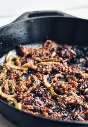 bulgogi frying in cast iron skillet
