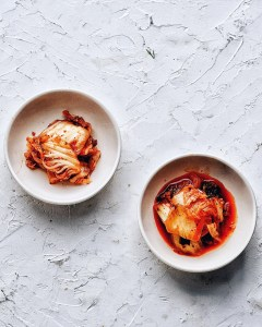 kimchi in two bowls with white background