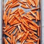 sweet potato strips on a sheet pan