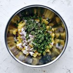 ingredients for pineapple salsa in stainless steel bowl