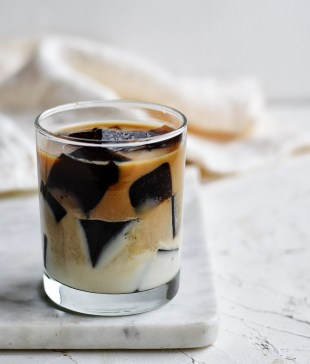 cup of coffee jello and sweet milk on white cutting board