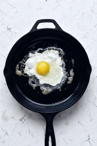 fried egg in cast iron skillet