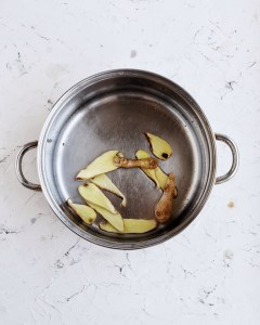 stainless steel pot with ginger slices