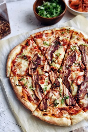 cropped picture of kimchi bacon pizza