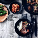 set table with korean food in dark dishes