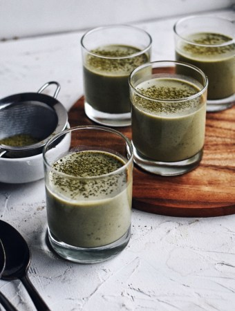 staggered group of glass cups filled with matcha coconut pudding
