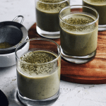 group of glass cups filled with matcha coconut pudding