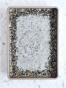 """batter for black sesame mochi cake and garnish around the edges in 9 x 13"""" pan"""