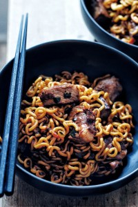 close up of chapaguri or ramdon in black bowl with chopsticks on the side