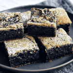 dark grey plate with black sesame mochi cake