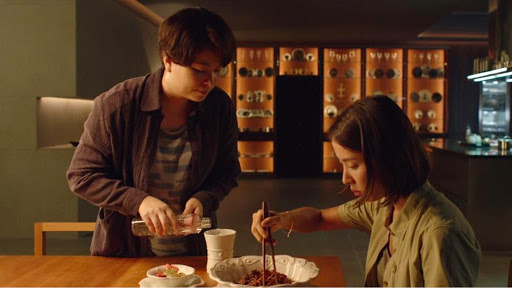scene from Parasite movie when rich mom eats chapaguri or ramdon