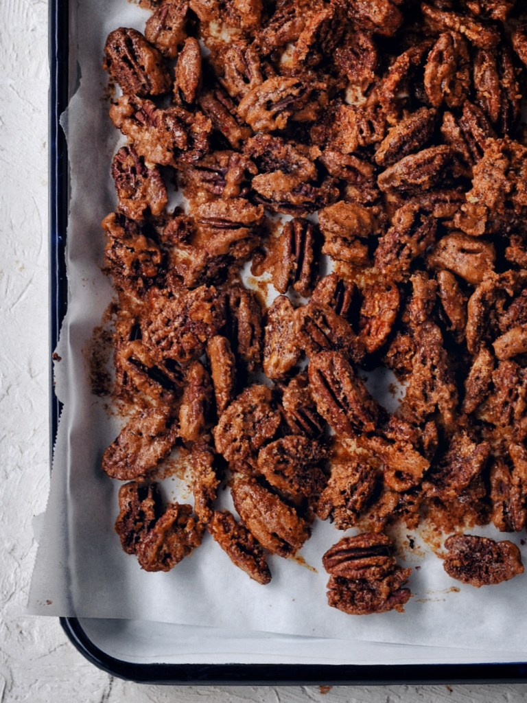 sheet pan of spicy candied pecans