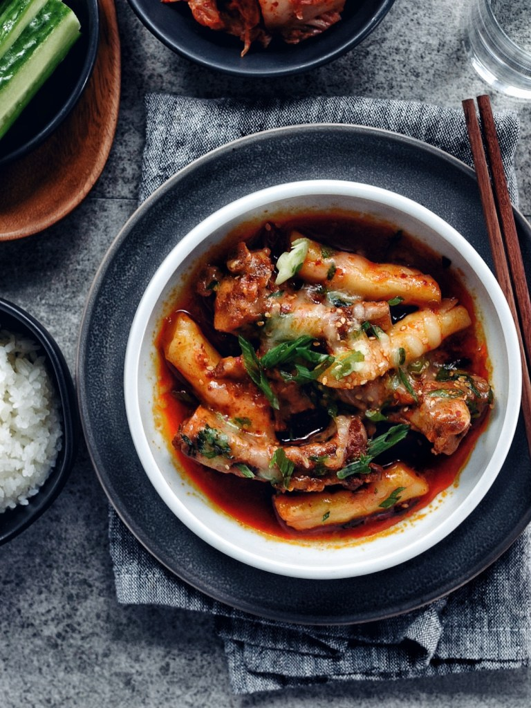 small bowl filled with spicy galbi jjim with bowl of rice