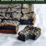 piece of black sesame mochi cake with bite