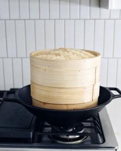 steamer baskets placed inside wok
