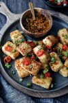 close up of air fryer panko tofu with green onions and red chili pepper