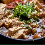 close up of clay pot filled with Korean Soybean Paste Stew (Doenjang Jjigae)