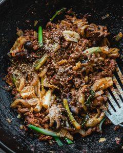 osam bulgogi in wok with spatula