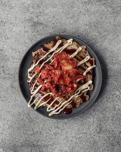 Japanese Okonomiyaki on grey plate with kimchi