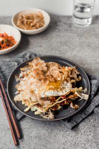 Japanese Okonomiyaki on table with chopsticks