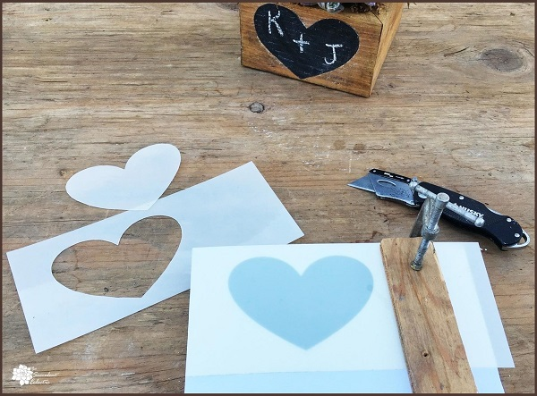Valentine's Day DIY cutting out heart stencil