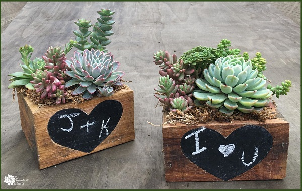 Valentine's Day DIY completed reclaimed wood planter with chalkboard heart
